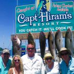 clients posing with caught fish